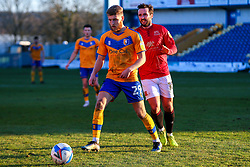 Aaron Wildig of Morecambe chases down Jason Law of Mansfield Town - Mandatory by-line: Ryan Crockett/JMP - 27/02/2021 - FOOTBALL - One Call Stadium - Mansfield, England - Mansfield Town v Morecambe - Sky Bet League Two
