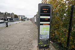Towpath beside Union Canal at Fountainbridge with display showing number of cyclists passing, in Edinburgh , Scotland, United Kingdom.