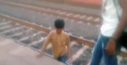 "Boy cheats death as train runs over him!<br /> <br /> A 13-year-old boy fell into the gap between the train and the platform while trying to board the train at Bamniya station of Jhabua, Madhya Pradesh, India. <br /> <br /> The incident around 6:30 am while the boy was trying to board the Mumbai-bound Janata Express, but lost his balance slipped into the gap.<br /> <br /> Before he could try to wriggle out of the gap between the platform and the tracks, the train departed. <br /> <br /> Eyewitnesses thought the boy was dead, but the boy had miraculous escape. He clung onto the platform wall till the train moved out of the platform. Much to the disbelief of the onlookers, he emerged unscathed from the tracks after that.<br /> <br /> Ravindra Kumar, the station master at Bāmnia, said: ""As soon as we received the information that someone has fallen on the tracks, I contacted the train guard and halted the train immediately. I must say the boy cheated death by his presence of mind.""<br /> <br /> https://www.youtube.com/watch?v=KHLWw70FLpw<br /> ©Exclusivepix Media"