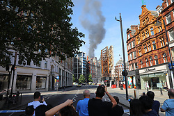 © Licensed to London News Pictures. 06/06/2018. London, UK. Fifteen fire engines and 97 firefighters and officers have been called to a fire believed to be at the Mandarin Hotel in Kightsbridge. Photo credit: Rob Pinney/LNP