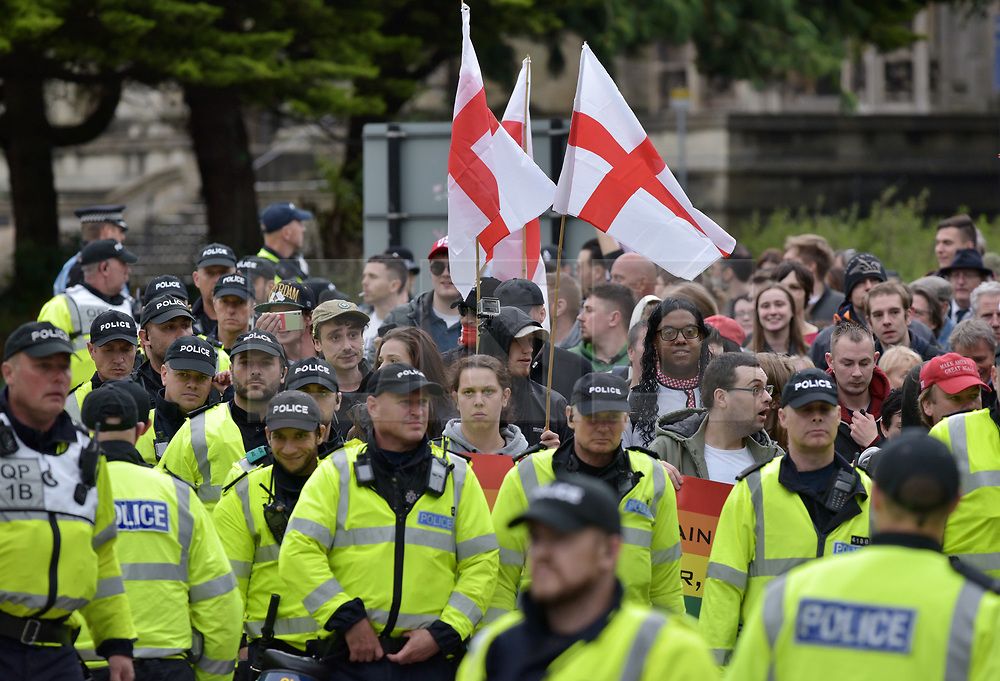 "© Licensed to London News Pictures.  10/09/2017; Bristol, UK. A group called British and Immigrants United Against Terrorism joins forces with another group called Gays Against Sharia to stage a demonstration in Bristol city centre. A counter-protest was also held called 'Stand Up To Racism and Bigotry'. A statement issued to oppose the march says that the demonstrators ""claim falsely that they are representing the views of the LGBT+ community in Bristol,"" adding: ""In fact, none of the organisers are LGBT+ and all the proposed speakers come from outside Bristol."" A heavy police presence Police with riot vans dogs and horses were in attendance. Police banned face coverings, masks, banners and flags 'that might incite hatred' ahead of today's protests. Picture credit : Simon Chapman/LNP"