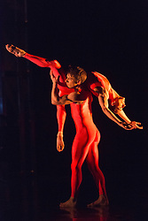 """© Licensed to London News Pictures. 12/05/2015. London, England. Duet performed by Luke Ahmet and Pierre Tappon. Rambert Dance Company perform the World Premiere of """"Dark Arteries"""" by Mark Baldwin as part of a triple bill at Sadler's Wells Theatre. Rambert perform with the Tredegar Town Band and the Rambert Orchestra from 12 to 16 May 2015. Photo credit: Bettina Strenske/LNP"""
