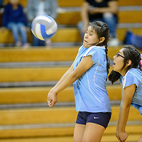 Window Rock Middle School Scouts Hannah Hames (10) returns a serve ahead of Sunshine Benally (11) from the St. Michael Indian School Cardinals at the Fort Defiance Field House Tuesday.