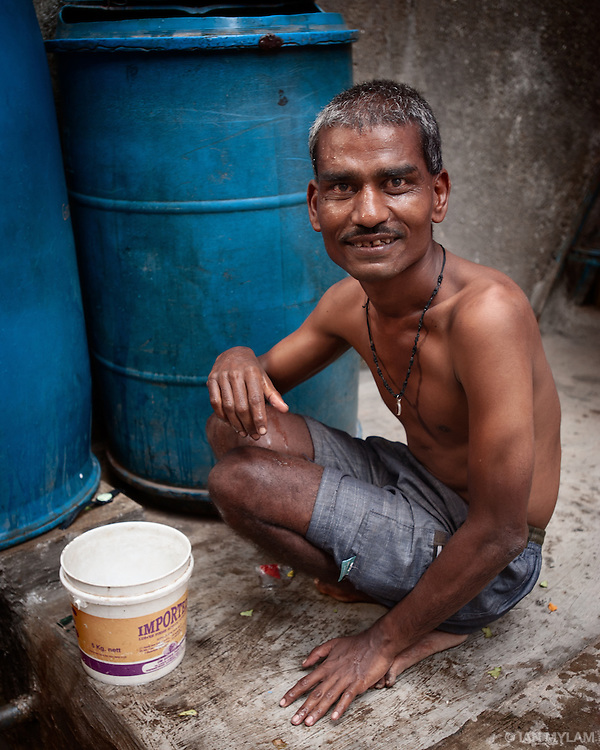 Man with Blue Drum - Dharavi, Mumbai, India