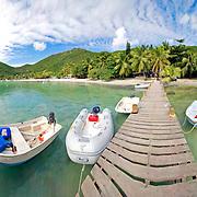 Boats on a jettty near Foxys Bar on Jost Van Dyke in the British Virgin Islands in the Caribbean. United Kingdom. High resolution panorama.