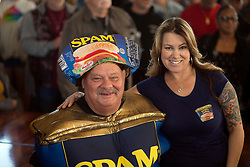 """""""Spam King"""" Paul Steele, left, poses with Sarah at the 22nd annual Spam Festival, Sunday, Feb. 16, 2019, in Isleton, Calif. Spam lovers competed for prizes by presenting their favorite Spam-infused foods, or entering the Spam-eating and Spam-toss contests. (Photo by D. Ross Cameron)"""
