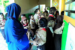 August 2, 2017 - Bukit Duri, Indonesia - BUKIT DURI, JAKARTA, INDONESIA, AUGUST - 02 : Health officers gave Measleas Rubela (MR) immunization injection to elementary school students (SD) 03 Bukit Duri, Jakarta on August 02,2017. The Ministry of Health is simultaneously conducting Campaign and MR immunization to children aged nine months to 15 years as a global commitment to eradicate rubella measles virus that can trigger disability and death in children throughout Indonesia. (Credit Image: © Dasril Roszandi/NurPhoto via ZUMA Press)