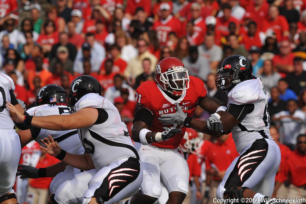 Sep 7, 2009; Piscataway, NJ, USA; Rutgers defensive end George Johnson (31) battles Cincinnati offensive lineman Sam Griffin (66) during the first half of Rutgers game against Cincinnati in NCAA college football at Rutgers Stadium.