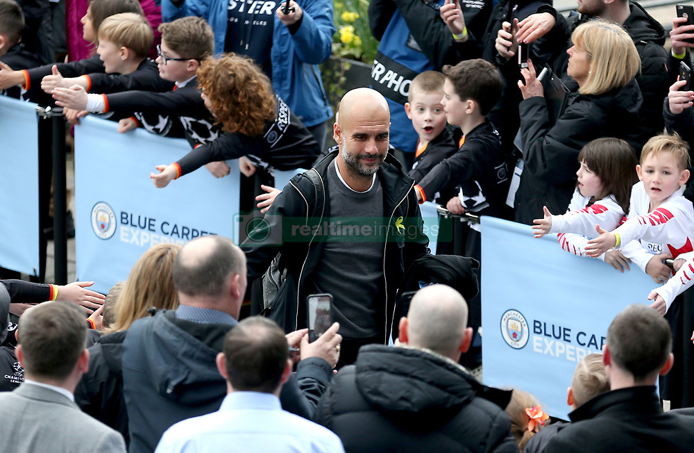 Manchester City manager Pep Guardiola acknowledges the fans as he arrives at the stadium before the match begins