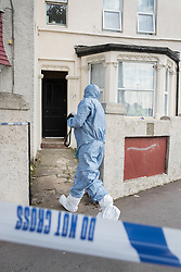 © Licensed to London News Pictures. 21/09/2017. London, UK. A police forensics officer prepares to take photographs of a property in Thornton Heath, south London where a 17 year old was arrested last night. This is the sixth arrest in connection with the bombing of an underground train at Parsons Green on September 15th. The bomb failed to fully explode but still injured 30 people. Photo credit: Peter Macdiarmid/LNP