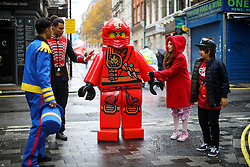 © Licensed to London News Pictures. 20/11/2016. London, UK. Over 400 cast members get ready to participate in Hamley's Toy Parade, which marches along Regent Street in London in a colourful extravaganza, with marching bands, dancers and toy vehicles. Photo credit: Tolga Akmen/LNP