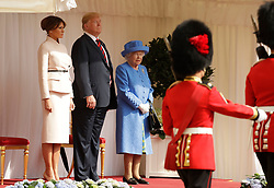 Queen Elizabeth II, US President Donald Trump and first lady Melania Trump look on as soldiers from the Coldstream Guards march past during a ceremonial welcome at Windsor Castle, Windsor.