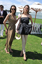 Left to right, ROSEY CHAN and  ANOUCK LEPERE at the 27th annual Cartier International Polo Day featuring the 100th Coronation Cup between England and Brazil held at Guards Polo Club, Windsor Great Park, Berkshire on 24th July 2011.
