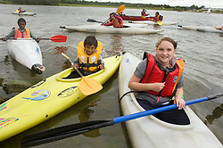Kids from the Guinness Northern Counties  Briary Close housing scheme in Wakefield Kayaking Pugneys Country Park on Thursday  26 August 2010 .Images © Paul David Drabble..