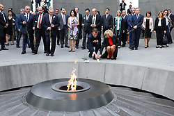 French President Emmanuel Macron and First Lady Brigitte Macron lay flowers at the Tsitsernakaberd Armenian Genocide Memorial in Yerevan, Armenia on October 11, 2018. Photo by Ludovic Marin/Pool/ABACAPRESS.COM