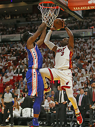 April 19, 2018 - Miami, FL, USA - The Miami Heat's Dwyane Wade, right, is fouled by the Philadelphia 76ers' Joel Embiid during the first quarter in Game 3 of a first-round NBA playoff series at AmericanAirlines Arena in Miami on Thursday, April 19, 2018. (Credit Image: © David Santiago/TNS via ZUMA Wire)