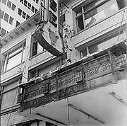 Y-580805-03.  Blue Mouse Theatre, marquee dismantled, old Globe Theatre sign revealed. 626 SW 4th. August 5, 1958