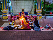 11 DECEMBER 2018 - SINGAPORE:  A Hindu priest leads a prayer at the Sri Sivan Temple in the Geylang neighborhood. The temple was originally built in 1850s in the area that in now Orchard Road. The temple was moved to its current site in Geylang in 1993. The Geylang area of Singapore, between the Central Business District and Changi Airport, was originally coconut plantations and Malay villages. During Singapore's boom the coconut plantations and other farms were pushed out and now the area is a working class community of Malay, Indian and Chinese people. In the 2000s, developers started gentrifying Geylang and new housing estate developments were built.    PHOTO BY JACK KURTZ