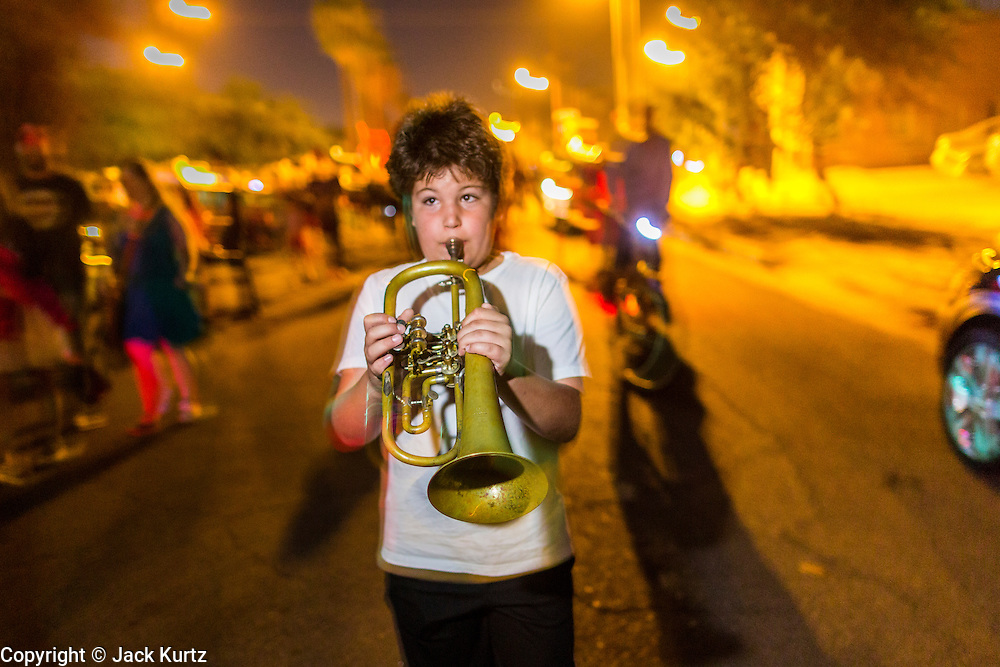 09 NOVEMBER 2013 - PHOENIX, AZ:  A boy plays the trumpet during the parade at the 7th annual Phoenix Annual Parade of the Arts. The arts walk/parade started in 2006 and now draws hundreds of people in downtown Phoenix.    PHOTO BY JACK KURTZ