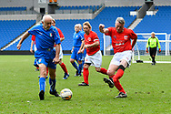 Alan Davies of England over 60's shoots at goal during the world's first Walking Football International match between England and Italy at the American Express Community Stadium, Brighton and Hove, England on 13 May 2018. Picture by Graham Hunt.