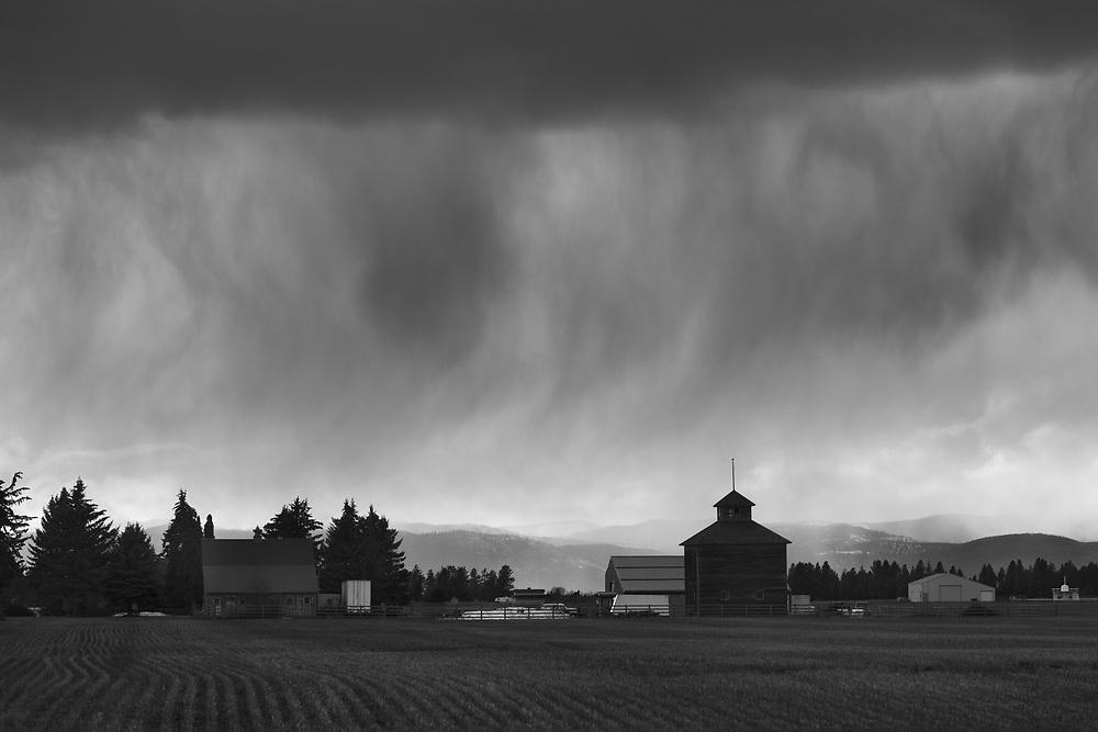 Passing storm over farmlands Southeast of Columbia Falls, MT.