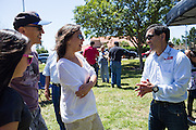 Nob Hill Foods assistant manager Patrick Koda shares stories with customers during a Nob Hill Foods farewell BBQ at Strickroth Park in Milpitas, California, on May 15, 2016. (Stan Olszewski/SOSKIphoto)