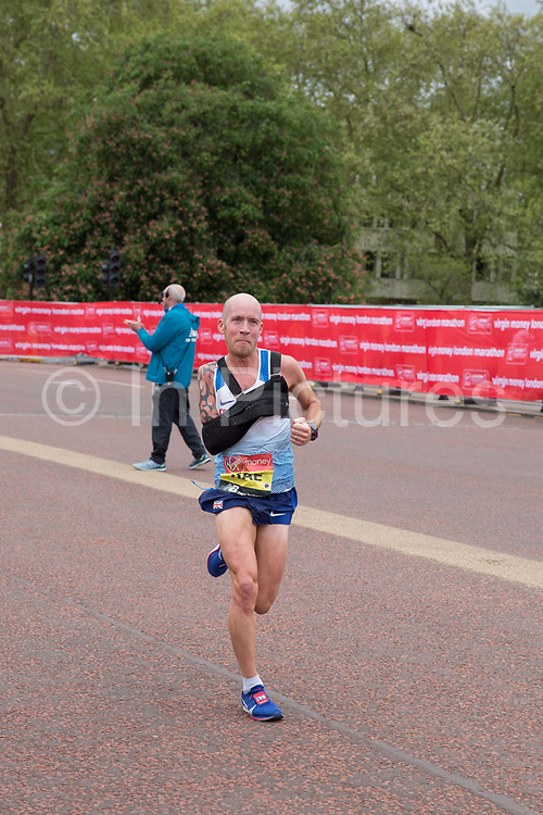 British para-athlete Derek Rae running at The Mall during The Virgin London Marathon on 28th April 2019 in London in the United Kingdom. Now in it's 39th year, the London Marathon is a large sporting event with over 40,000 runners expected to take part.