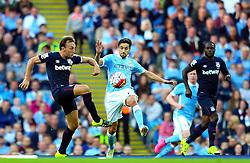 Mark Noble of West Ham tackles Jesus Navas of Manchester City  - Mandatory byline: Matt McNulty/JMP - 07966 386802 - 19/09/2015 - FOOTBALL - City of Manchester Stadium - Manchester, England - Manchester City v West Ham United - Barclays Premier League