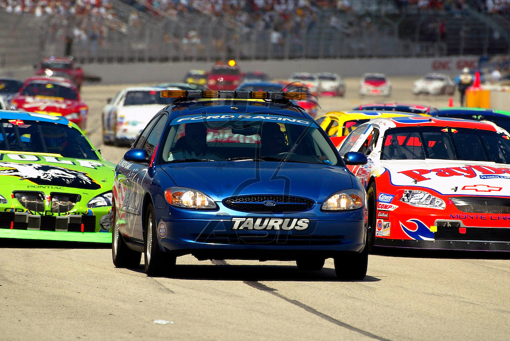 The Ford Taurus Pace Car leads the field off the front stretch before the running of the GNC Live Well 250 NASCAR Busch Grand National race at the Milwaukee Mile in West Allis, Wisconsin.