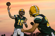 BFA's Nate Loughlin (10) passes the ball during the football game between the Mount Mansfield Cougars and the BFA St. Albans Bobwhites at BFA High School on Friday night September 7, 2018 in St. Albans. (BRIAN JENKINS/for the FRESS PRESS)