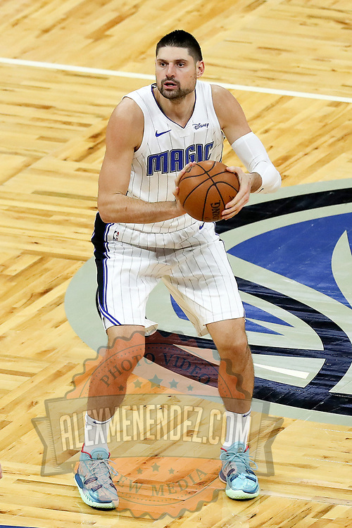 ORLANDO, FL - FEBRUARY 23:  Nikola Vucevic #9 of the Orlando Magic controls the ball against the Detroit Pistons at Amway Center on February 23, 2021 in Orlando, Florida. NOTE TO USER: User expressly acknowledges and agrees that, by downloading and or using this photograph, User is consenting to the terms and conditions of the Getty Images License Agreement. (Photo by Alex Menendez/Getty Images)*** Local Caption *** Nikola Vucevic