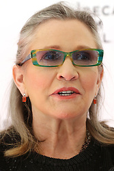 File photo dated 4/19/16 of Carrie Fisher, who has died at age 60