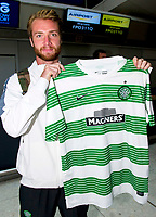 29/07/14   <br /> GLASGOW AIRPORT<br /> New Celtic signing Jo Inge Berget proudly poses at Glasgow Airport ahead of flying to Warsaw