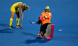 Argentina's Belen Suscci celebrates as Australia's Maddy Fitzpatrick looks dejected during penalty shootout