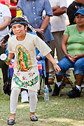 """June 13 - PHOENIX, AZ: KARITIA FRANCO, 8, from Glendale, AZ, performs a dance honoring the Virgin of Guadalupe during an immigrants' rights rally and vigil at the Arizona State Capitol in Phoenix Sunday. About 40 immigrants' rights activists from Anaheim, California, joined Phoenix area activists at the Arizona State Capitol Sunday for a prayer vigil and rally against SB 1070, the Arizona law that gives local law enforcement agencies the power to ask to see proof of immigration status in the course of a """"lawful contact"""" and when """"practicable."""" Immigrants' rights and civil rights activist say the bill will lead to racial profile. Proponents of the bill say it is the toughest local anti-immigration bill in the country and merely brings state law into line with federal immigration law.  The law, which was signed by the Arizona Governor in April, goes into effect on July 29, 2010.   Photo by Jack Kurtz"""
