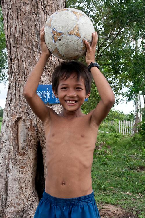 Young kid with a football near Battambang in Cambodia.