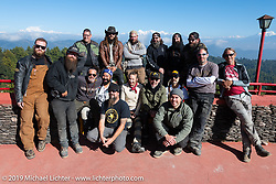 Our great group in Daman with the white peaks in the background at the Everest Panorama Resort. (standing L>R) Patrick Lies, Mikey Revolt, Tim Statt, Danger Dan, Bear Haughton, Gary Thomas, Chris Drew, Justin Big Meas Wilson, Jason Adamski, Doug Wothke, (kneeling L>R) Coolbeans Chris Marino, Buddi Singh, Pat Patterson, Danita Gayle, Christopher Galley, Rob Galen and Geoff Kowalchuk on Motorcycle Sherpa's Ride to the Heavens motorcycle adventure in the Himalayas of Nepal. Riding from Daman back to Kathmandu. Wednesday, November 13, 2019. Photography ©2019 Michael Lichter.