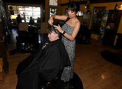May 3, 2019 - Upland, California, U.S. - Hair Secret owner Sophirian Kim cuts the hair of customer Brenda Toepfer in downtown Upland Friday, May 3, 2019, Kim has owned the salon for 6 years. For the first time in eight years, Upland is giving promotional funds to the Historic Downtown Upland association, which will be used to fund promotional opportunities to bring business down to the cityÃ•s heart. Business leaders say the promotional events are the equivalent of Black Friday for many of them, and also help drive business throughout the year by making thousands of visitors aware of what downtown has to offer. (Credit Image: © Will Lester/SCNG via ZUMA Wire)