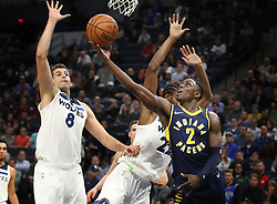 October 24, 2017 - Minneapolis, MN, USA - The Indiana Pacers' Darren Collison (2) scores over the Minnesota Timberwolves' Nemanja Bjelica (8) and Andrew Wiggins in the second half at Target Center in Minneapolis on Tuesday, Oct. 24, 2017. The Pacers won, 130-107. (Credit Image: © Jerry Holt/TNS via ZUMA Wire)