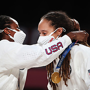 TOKYO, JAPAN August 8:  Brittney Griner #15 of the United States receives her gold medal from team mate Tina Charles #14 of the United States during the medal presentations after the teams victory during the Japan V USA basketball final for women at the Saitama Super Arena during the Tokyo 2020 Summer Olympic Games on August 8, 2021 in Tokyo, Japan. (Photo by Tim Clayton/Corbis via Getty Images)