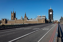 © Licensed to London News Pictures. 23/03/2020. London, UK. A near-empty Westminster Bridge as people continue to avoid central London. The government has refused to rule out tougher measures to enforce social distancing if people do not begin following the health advice. Photo credit: Rob Pinney/LNP
