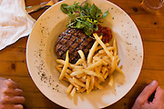 Steak and French fries: Close up of pub lunch plate at the White Horse Inn at Hascomb, UK. Lunch with Richard and Fenella Hodson, Godalming, UK. (Material World Family from Great Britain UK) and photographer David Reed.