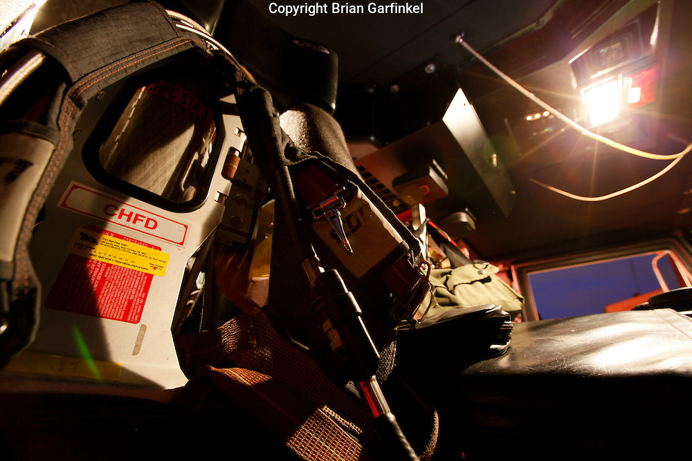 The officers seat of a fire truck with an SCBA.