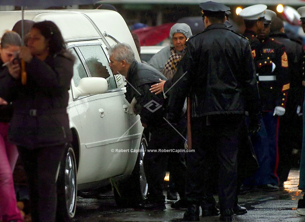 A mourner kisses the hearse carrying the body of Nixzmary Brown after her funeral at St. Mary's Coming Church on the Lower East Side Wednesday, January 18, 2006. The police say her stepfather beat her to death the previous Wednesday.