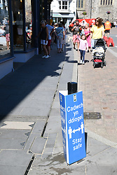 Social distancing sign during Covid pandemic, Tenby, Pembrokeshire, South Wales July 2021