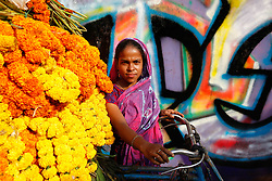 February 4, 2018 - Dhaka, Bangladesh - A Bangladeshi woman,  Shirin Begum 25 years old sales flowers in Dhaka, Bangladesh, on February 6, 2018. (Credit Image: © Mehedi Hasan/NurPhoto via ZUMA Press)