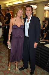 LADY MARIA BALFOUR and CHARLIE WIGAN at '4 Inches' a project 'For Women about Women By Women' - A photographic Auction in aid of the Elton John Aids Foundation hosted by Tamara Mellon President of Jimmy Choo and Arnaud Bamberger MD of Cartier UK at Christie's, 8 King Street, London W1 on 25th May 2005.<br />