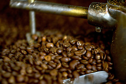Freshly roasted coffee beans are stirred in the cooling tray of the roaster, at Devout Coffee, Tuesday, April 5, 2016, in Fremont, Calif. Ideally, the beans will cure for several days before actually being ground and brewed for drinking. (Photo by D. Ross Cameron)