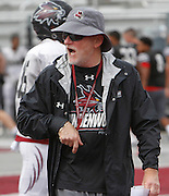 Lindenwood University-Belleville head football coach Dale Carlson gives instructions to players during practice.