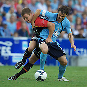 Scott Jamieson (left) and Karol Kisel clash during the Sydney FC V Adelaide United A-League match at the Sydney Football Stadium, Sydney, Australia, 27 December 2009. Photo Tim Clayton
